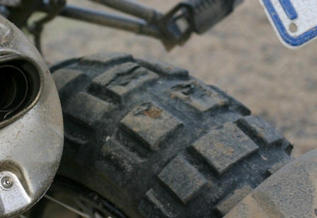 The rear tyre on Miles's BMW before the climb...